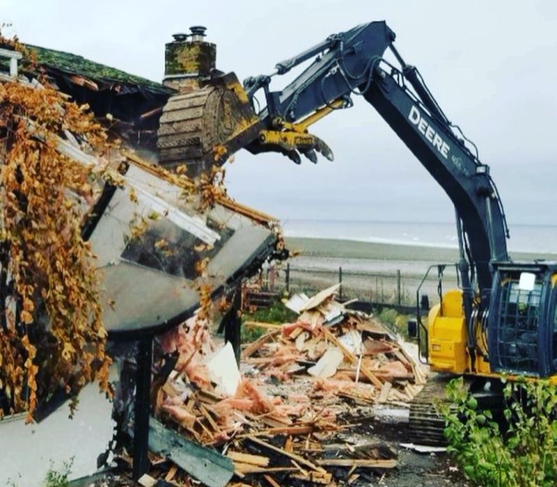 removing wood with construction equipment
