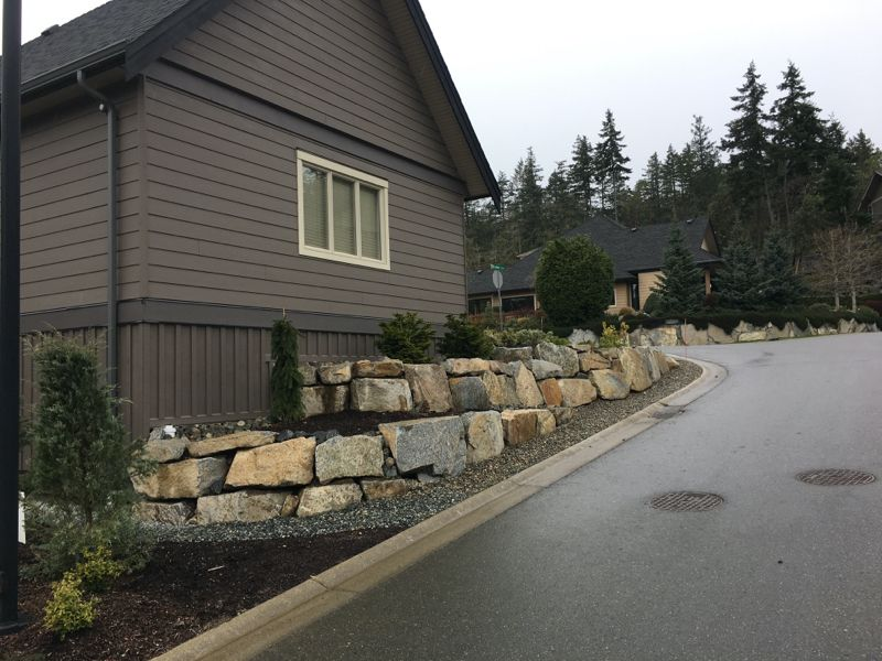 brown house and rock wall