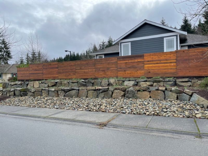 rock wall under residential fence